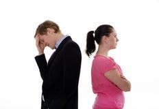 Giovani coppie disturbate Fotografia Stock