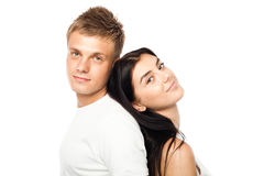 Giovani coppie felici in vestiti casuali immagine stock