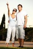 Giovani coppie piacevoli nella sosta Fotografia Stock