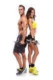 Giovani coppie sportive di bella forma fisica con la testa di legno fotografie stock
