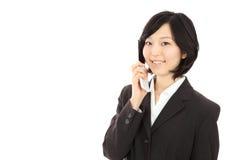 Giovani donne asiatiche da chiamare Immagine Stock