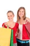 Giovani donne con i sacchetti di acquisto fotografie stock