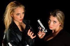 Giovani donne con le pistole Fotografia Stock