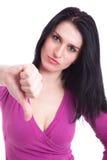 Giovani donne graziose con il pollice giù Immagine Stock Libera da Diritti