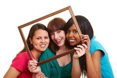 Giovani donne nel telaio Fotografia Stock