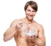 Giovani fiocchi mangiatori di uomini muscolari Immagini Stock Libere da Diritti