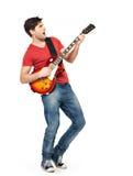 Giovani giochi del chitarrista sulla chitarra elettrica Fotografia Stock