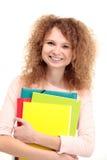 Giovani libri felici della holding della ragazza dell'allievo Fotografia Stock