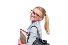 Giovani libri felici della holding della ragazza dell'allievo Di nuovo al banco Fotografia Stock