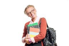 Giovani libri felici della holding della ragazza dell'allievo Di nuovo al banco Immagine Stock