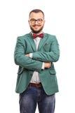 Giovani pantaloni a vita bassa sicuri con un cappotto verde immagini stock libere da diritti