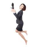 Giovani pattini felici di salto e del tiro della donna di affari Fotografie Stock