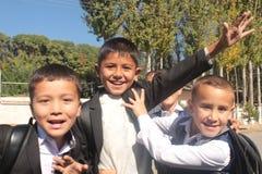 Giovani ragazzi di scuola felici Immagine Stock Libera da Diritti