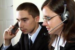 Giovani specialisti del servizio d'assistenza nel lavoro Immagine Stock Libera da Diritti