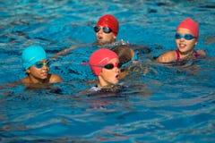 Giovani triathletes nell'acqua. fotografia stock libera da diritti