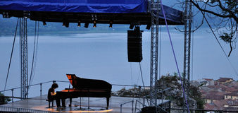 Giovanni Allevi piano concert outdoor. Lake view Royalty Free Stock Image