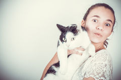 Gioyful girl with cat Stock Image