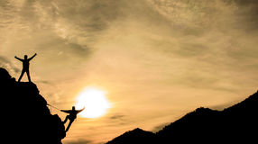 Gipfelerfolg und -glück Stockfoto