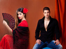 Gipsy flamenco dancer couple from Spain. With red rose and spanish hand fan Royalty Free Stock Images