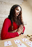 Gipsy girl predicts the future on cards. Stock Image