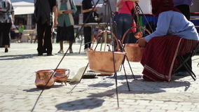 Gipsy Woman Selling Pots stock video footage