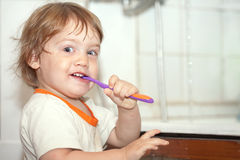 Gir brushes her teeth Royalty Free Stock Photography