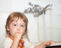Gir brushing her teeth in bathroom Royalty Free Stock Photo