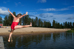 Gir ljumping in river Royalty Free Stock Images