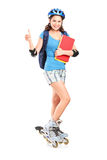 Gir Lon Rollers Holding Notebooks And Thumb Up Royalty Free Stock Photo