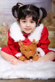 Gir in red. Toddler sitting with her teddy for her Valentine's day photoshoot Royalty Free Stock Photo