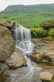 Gira Falls, Waghai. A waterfall is a place where water flows over a vertical drop in the course of a stream or river. Waterfalls also occur where meltwater drops Royalty Free Stock Image
