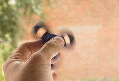 Girador da inquietação das posses à disposição, Foto de Stock