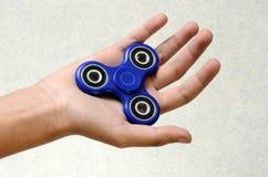 Girador da mão, brinquedo remexendo-se da mão Foto de Stock