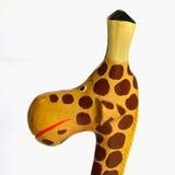 Girafa de madeira bonito - opinião lateral do close up Fotografia de Stock