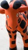 Girafe orange Clay Doll Photographie stock libre de droits