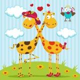 Girafes garçon, fille et oiseau Photographie stock libre de droits