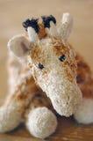 Giraffa triste della peluche Fotografia Stock