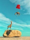Giraffe που στέκεται σε έναν μεγάλο βράχο Στοκ φωτογραφία με δικαίωμα ελεύθερης χρήσης