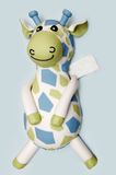 Giraffe Cake. Children's birthday cake of a cute toy giraffe, with gift card for personal message Royalty Free Stock Image
