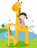 Giraffe and children Stock Photo