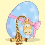 Giraffe with egg Stock Images