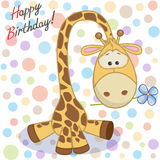 Giraffe with flower Stock Images