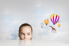 Giraffe flying on balloons Stock Photos