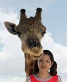 Giraffe with girl Stock Photo