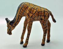 Giraffe made from leather. Against a blue background Stock Photography
