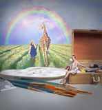 Giraffe and rainbow. Surreal scene of woman and giraffe under rainbow stock photo