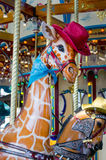 Giraffe with a red had and blue bandana Royalty Free Stock Photography