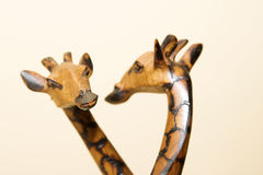 Giraffe Reflection. A wooden giraffe figurine and its reflection stock images