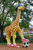 Giraffe with soccer ball made by lego Stock Image