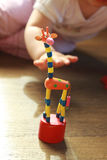 Giraffe toy. Baby's hand reaching for a giraffe toy Stock Photo